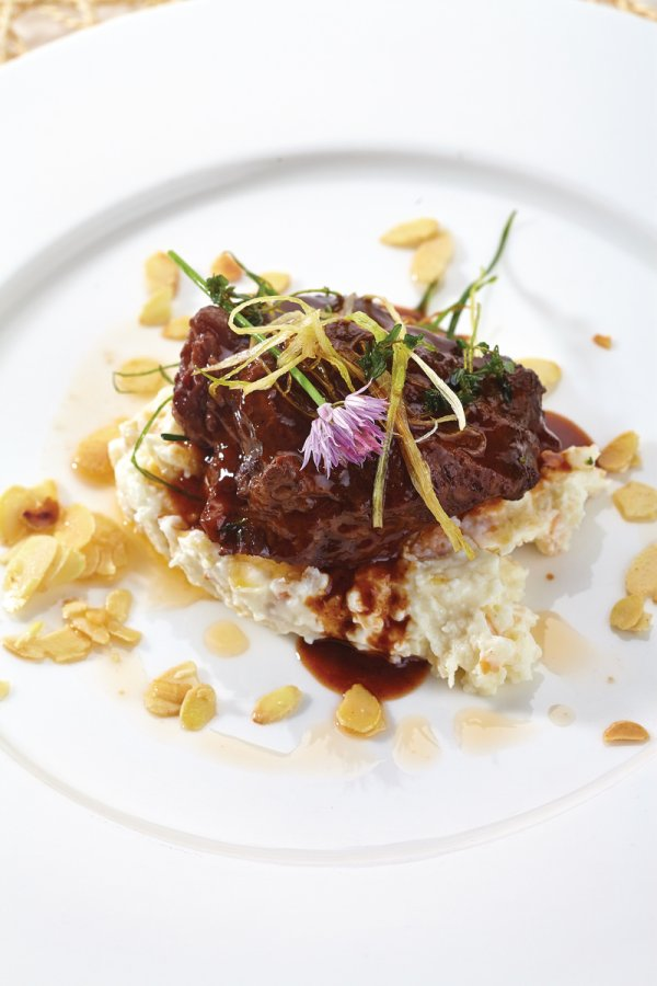 Boiled veal cheeks over almond risotto purée
