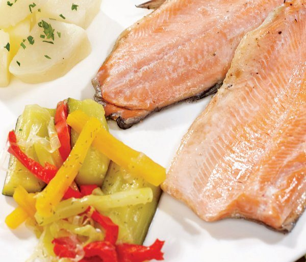 Poached trout with lemon a side of steamed vegetables buttered potatoes